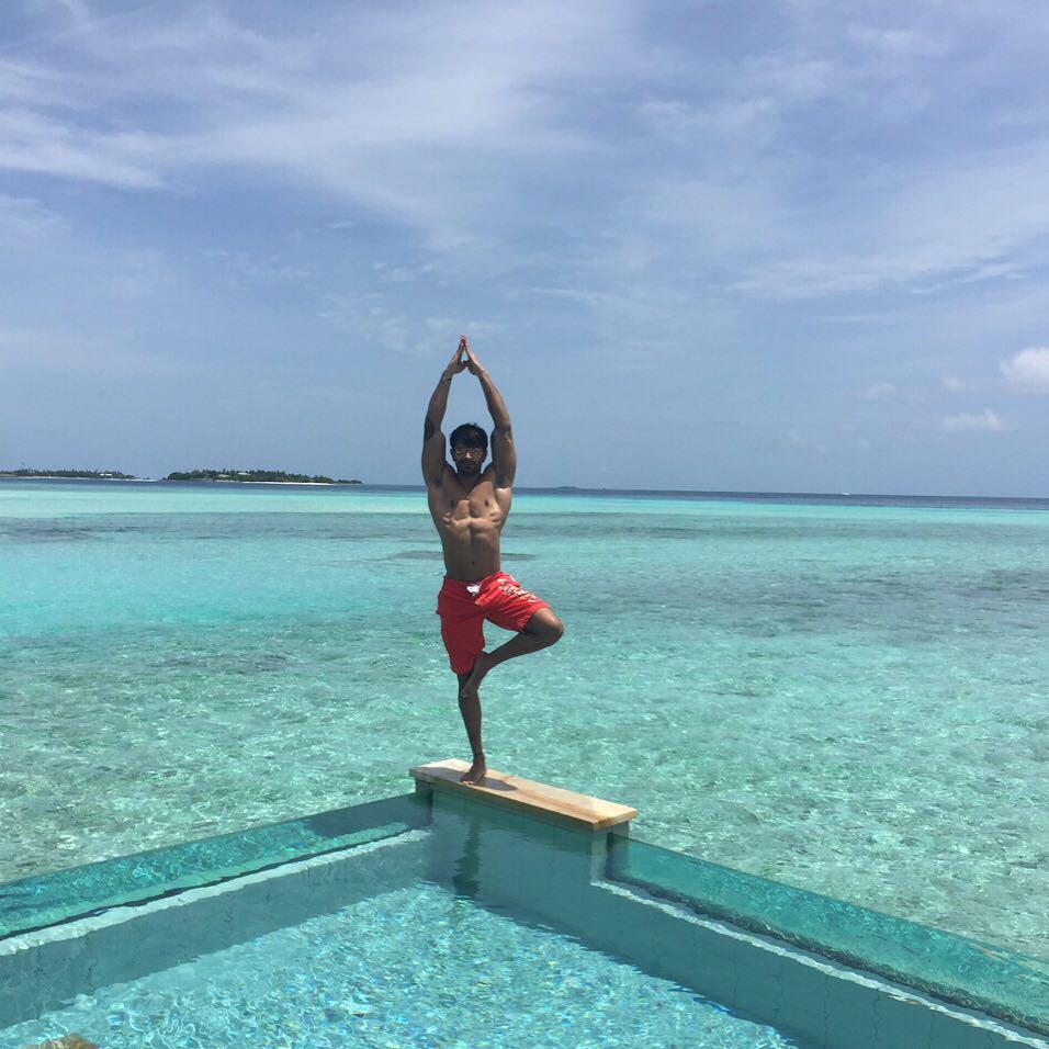 Karan Singh Grover Performing Yoga Above The Water At Maldives