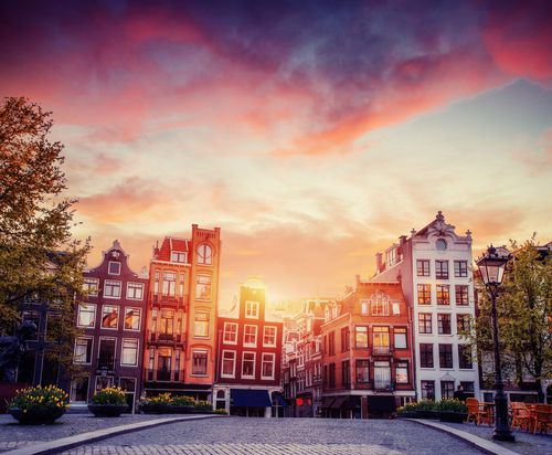 Amsterdam canal on the west. Amsterdam is the capital and most densely populated city in the Netherlands. - Shutterstock